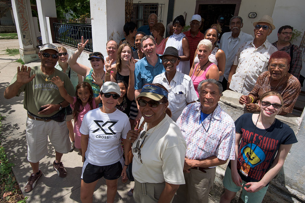 Members of our group and a Cuban senior dance group (and their grandchildren) posing on the porch of their community center after we had dance lessons.