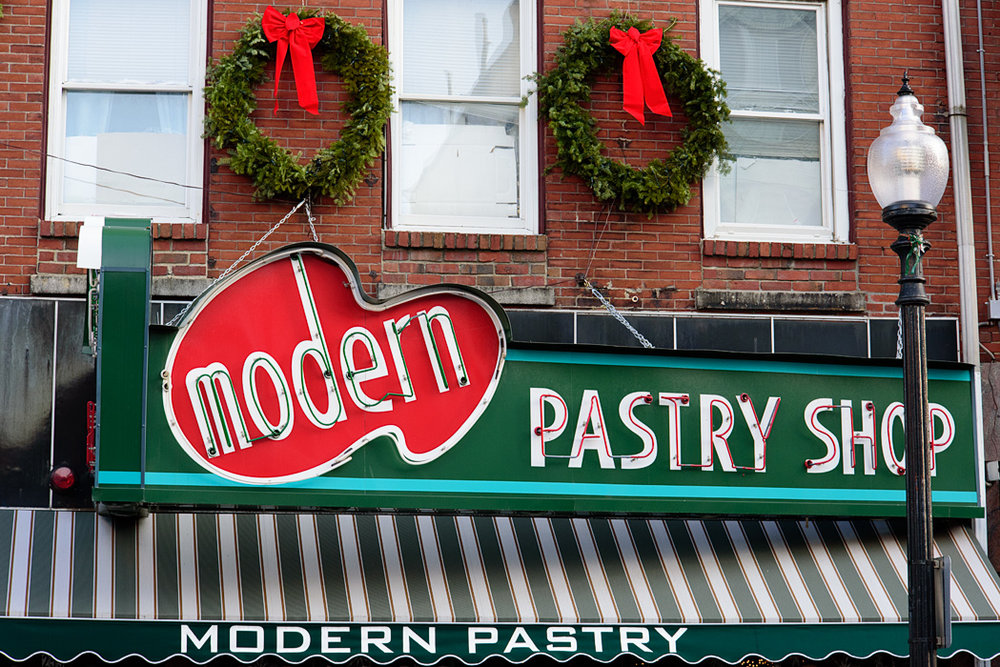 It's worth waiting in line with locals shopping for their holiday table to enjoy a Modern's lobster tail or cannoli in Boston's North End.