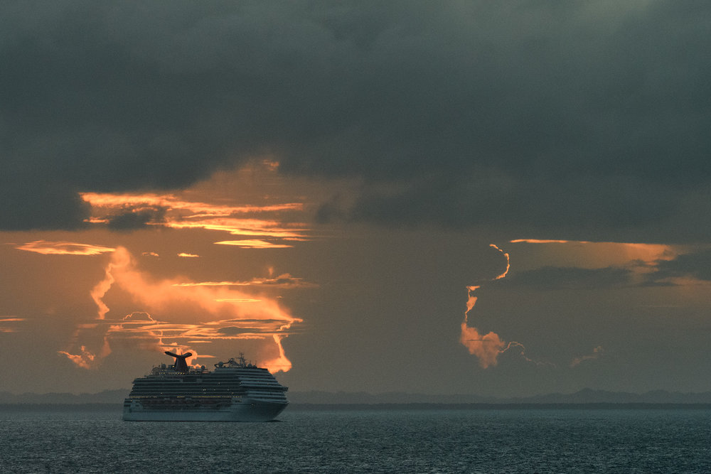A Carnival ship is silhouetted by the dramatic sunset as we left Belize.