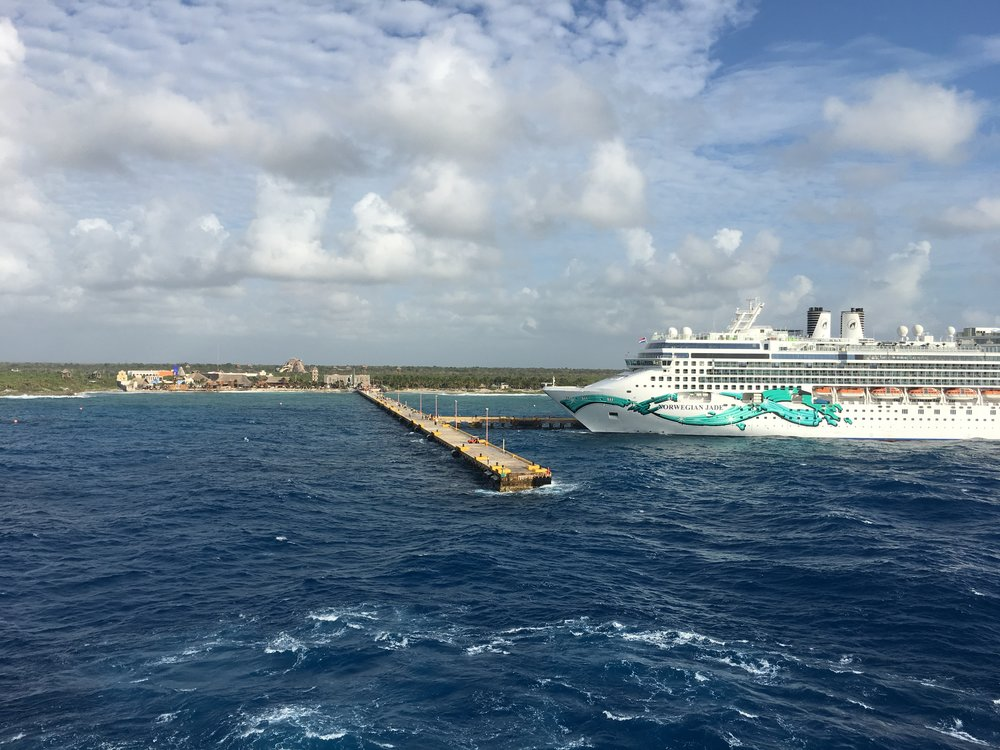 With swells coming 10-15 feet up on the side of the ship, and two ships already in the safest docking spots, the Captain decided there was no way to keep the gangway safe for passengers if we docked in Costa Maya.