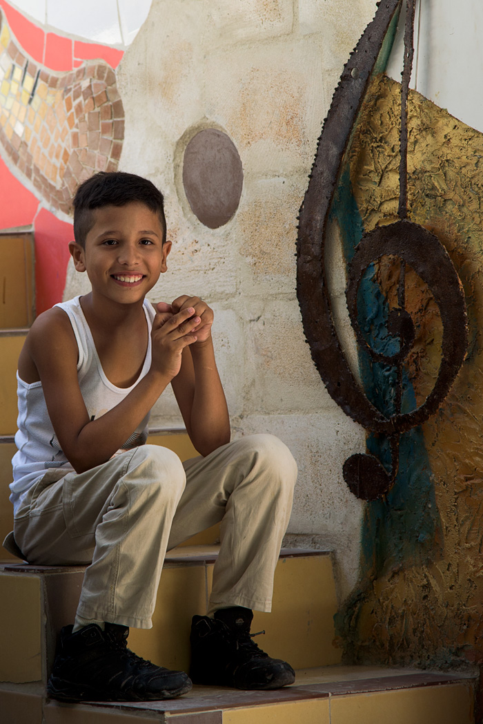 A young man shares his art and a smile with visitors
