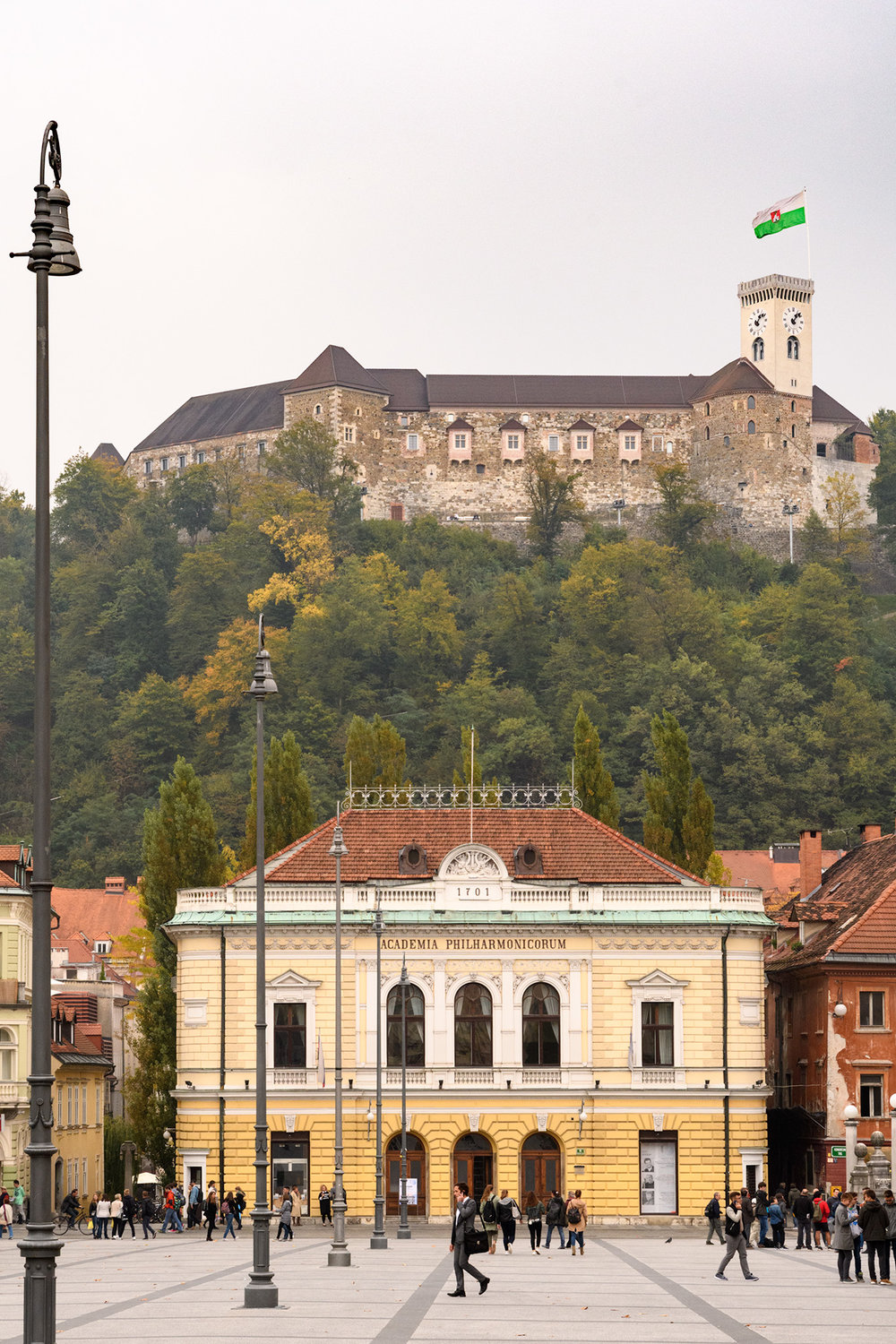 The opera house in Kongresni Square with the LjubljanaCastle looming above.