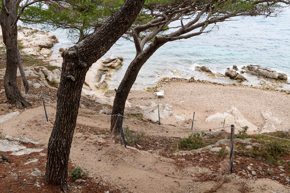 One of the rocky beaches that line Cavtat, and attract beach goers in the summer.