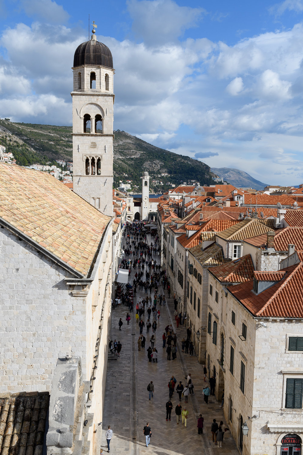 The Stradun from above on the walls, with views of the Sponza Palace in the background and the near tower of the Franciscan Monastary in the foreground.