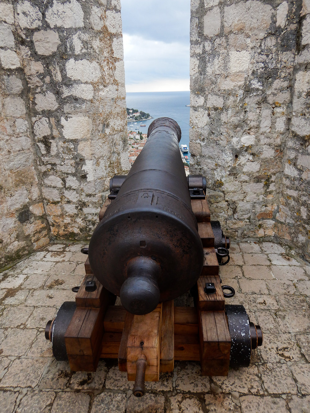 A cannon at the fort, and the chapel up at the fort and views of the town below (click on any image below to expand)