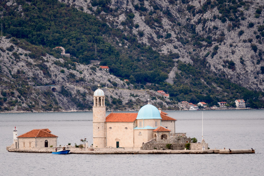 Out in the Bay of Kotor, Our Lady of the Rock can be accessed by a short inexpensive boat trip from Perast. Inside the church, you can see the Madonna and Child icon that inspired the church.