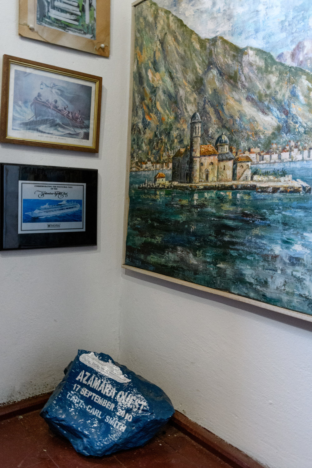 "The Azamara Quest ""rock"" added at the museum in Our Lady of the Rock, above the rock is a painting of the church, built upon a bed of rocks piled in the bay over the years."