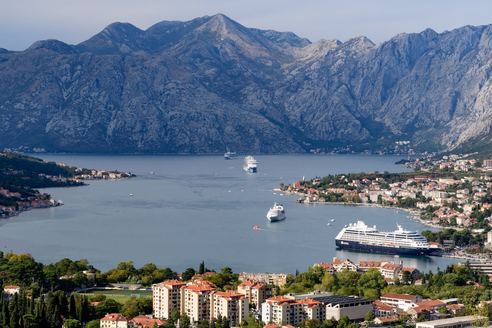 Views of the bay from the mountain high above Kotor, wiht multiple cruise ships docked and anchored.