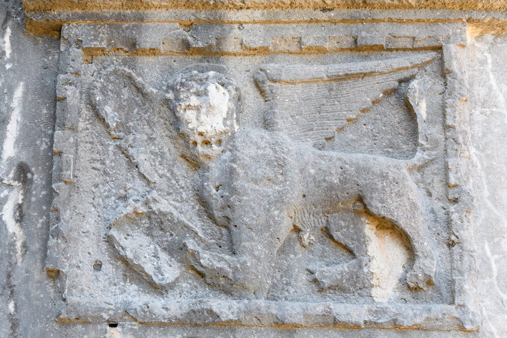 Corfu is a place with evidence of many influences; including Venetian, as seen in this building bearing the winged lion, symbol of the Venice.