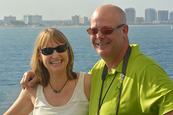 Kathy with her new friend, Randy back in 2013...on his first, but certainly not LAST cruise.  Our spouses, Jeff and Amy tolerate our obsessive planning because they get to enjoy the cruise too!