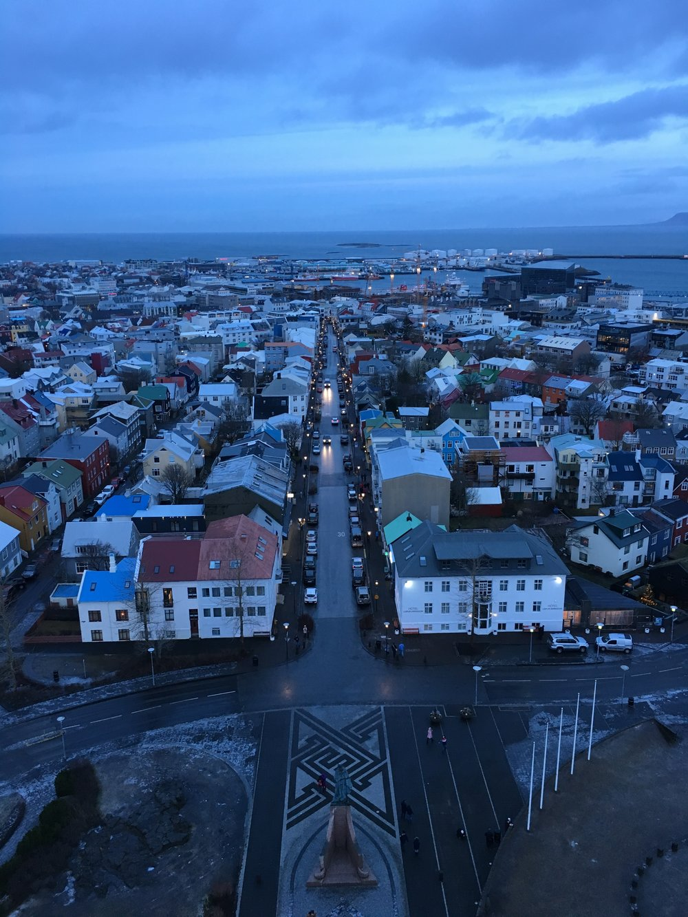 "The iconic view from the tower of the Hallgrímskirkja Lutheran Church in Reykjavik. This version is at ""dawn"" around 11 AM in mid January."