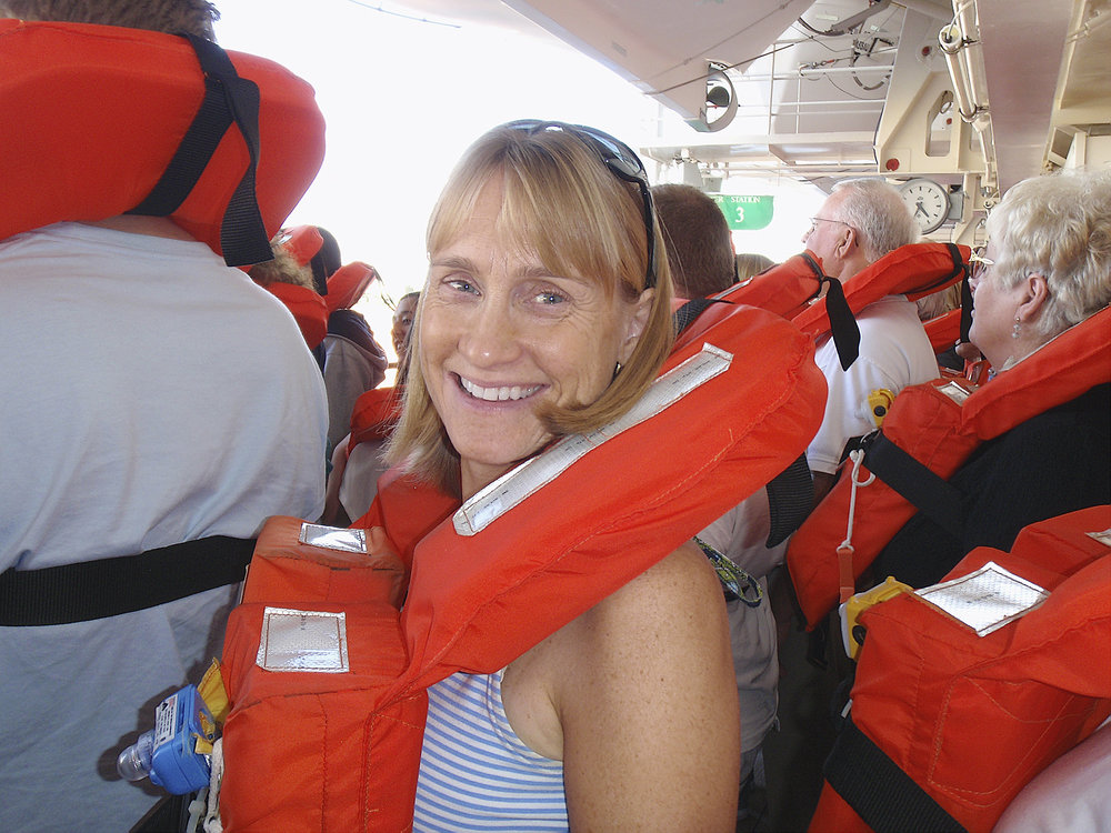 Most ships no longer require you to wear your life vest to muster, but its a good idea to know where they are in your cabin before you go to muster.