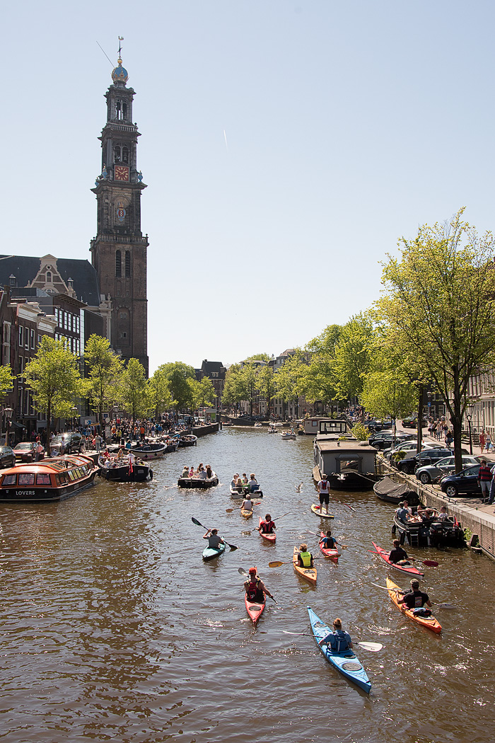 Westerkerk looms over guests on a kayaking tour on the canals
