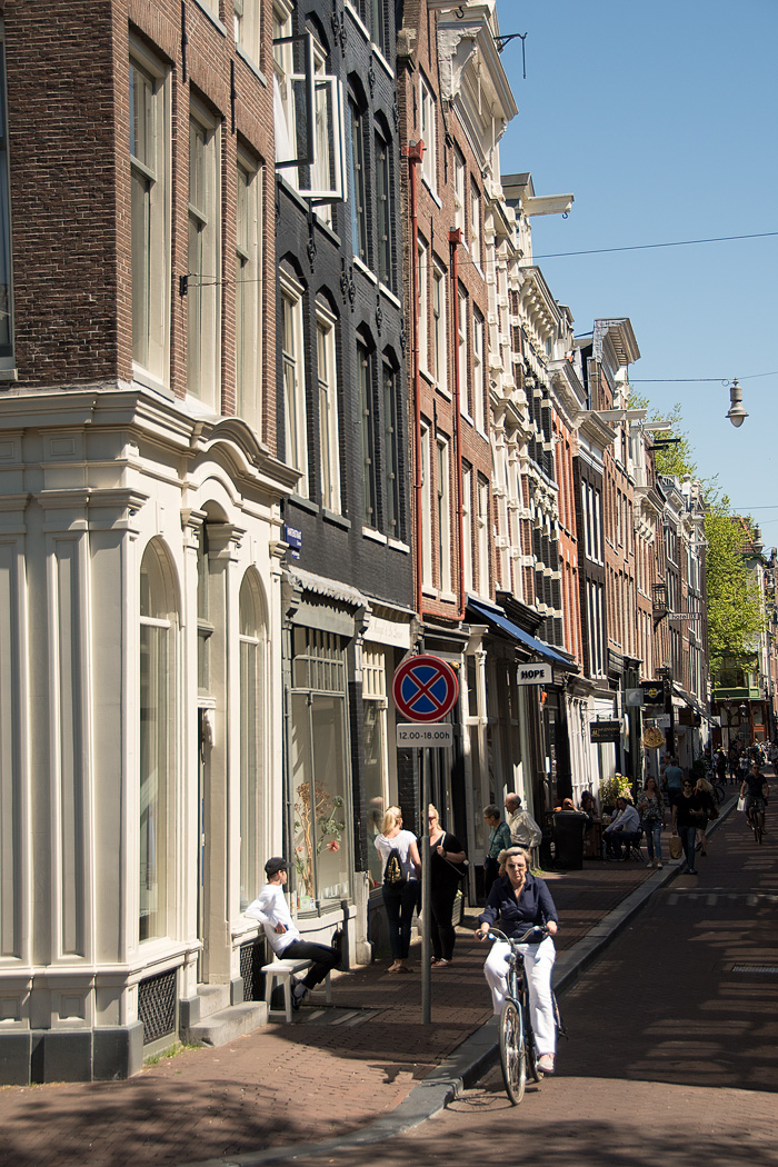 "The fashionable ""9 little streets"" district, crossing over 6 bridges and 3 canals is lined with local shops and cafes in the Jordaan Area"