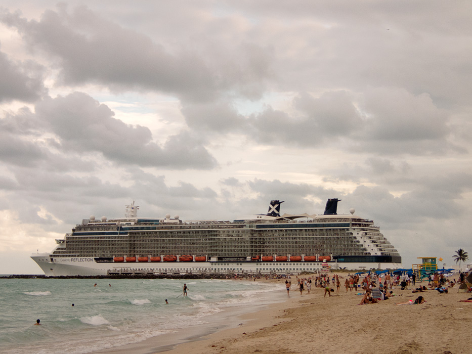 "A cruise ship appears nearly ""beached"" as it makes its way out of the Intercoastal Waterway past the South Pointe Pier"