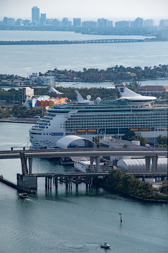 Watch the cruise ships come into port from Brickell Ave tower hotel