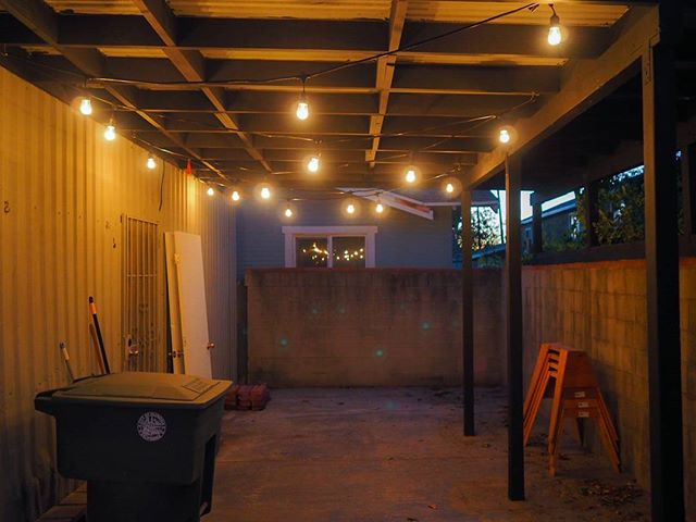 string lights went in!! #thehousethatwaited #pergola #stringlights #concretebackyard #homeimprovement