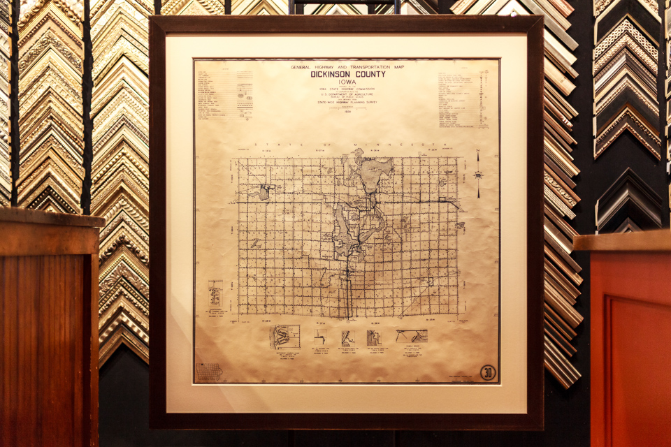 Vintage county map framed in reclaimed wood frame.