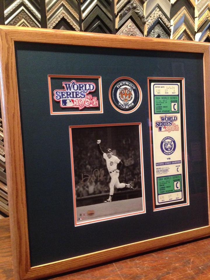 Detroit Tiger memorabilia matted in team colors and framed in baseball bat ash frame.
