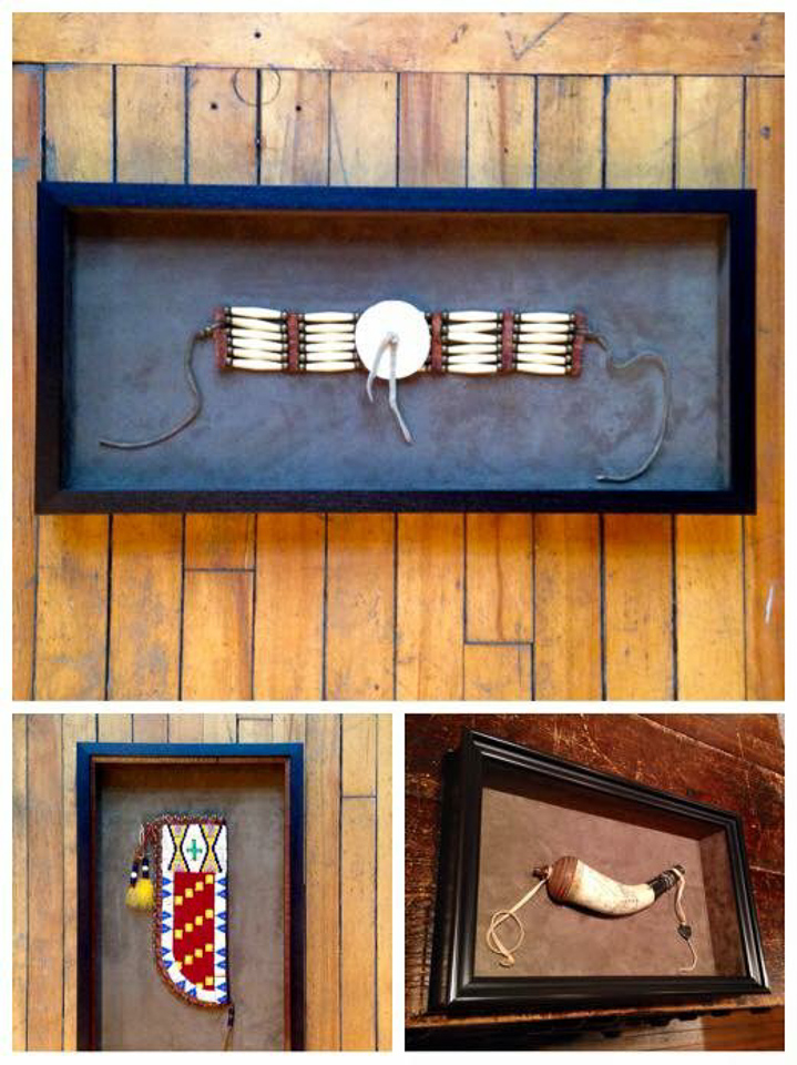 Shadowboxed Native American artifacts.