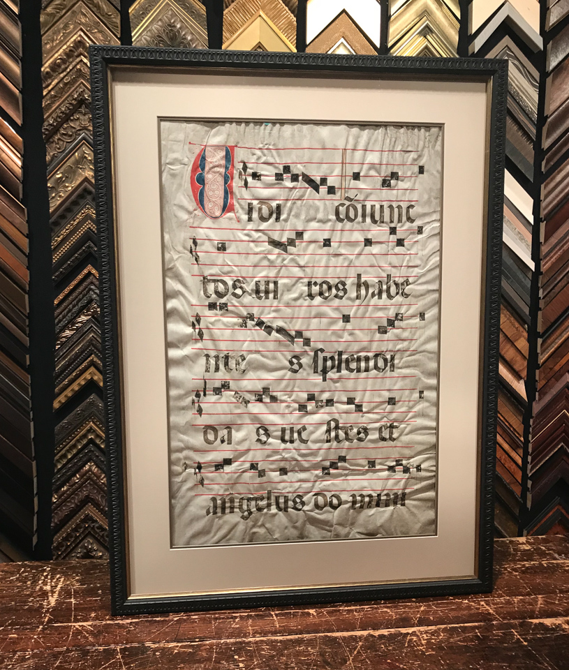 Music inked onto sheepskin parchment framed double sided.