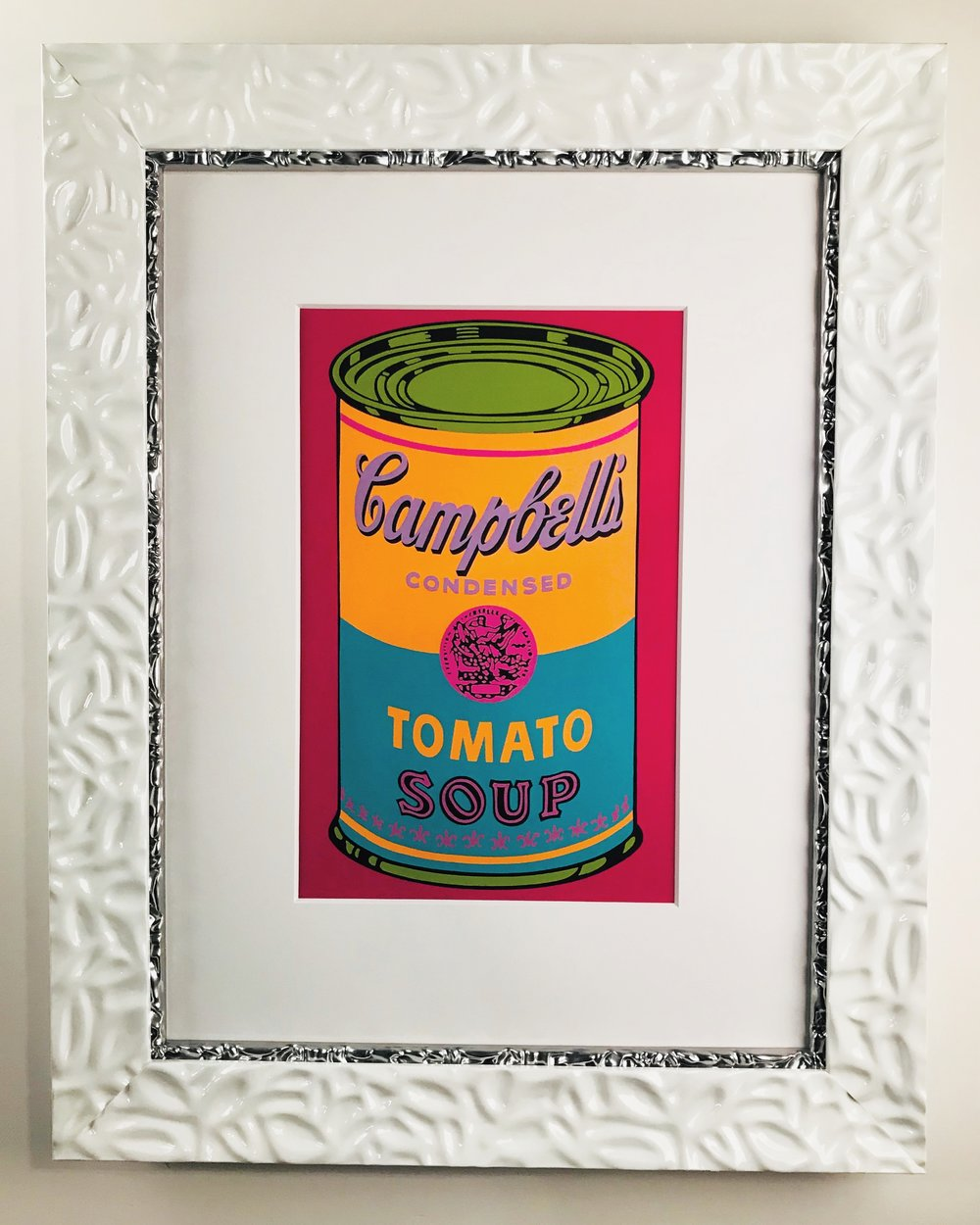 Tomato Soup by Andy Warhol framed in gloss white with graphite insert.