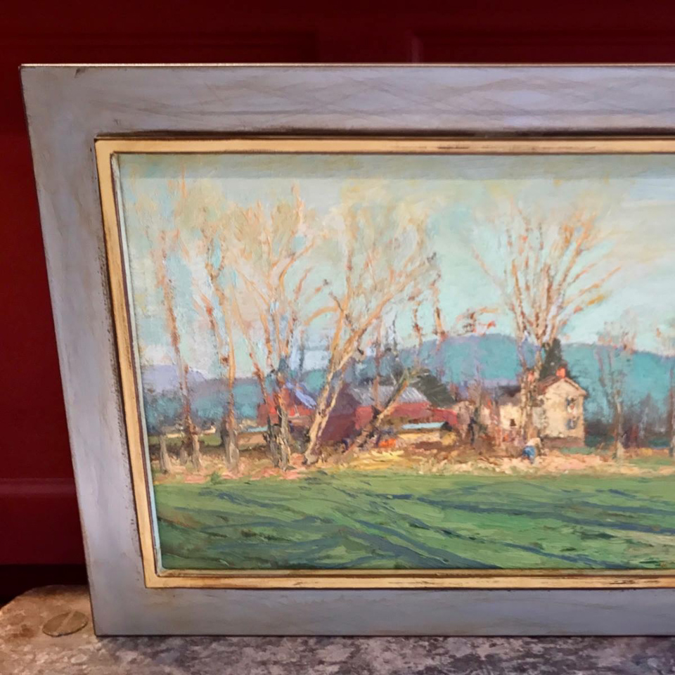 Lovely landscape painting framed in welded steel frame.