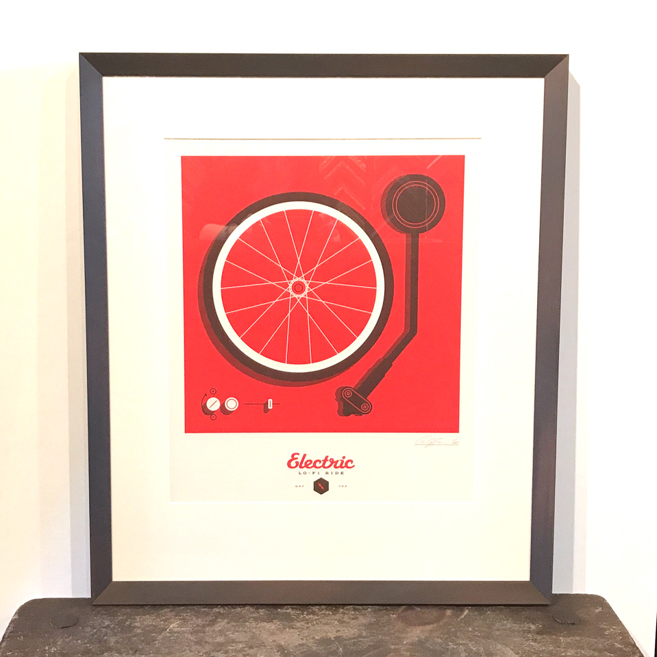 Artcrank print - Electric Lo-Fi Ride by Adam Hoganson- framed in angled cocoa frame.