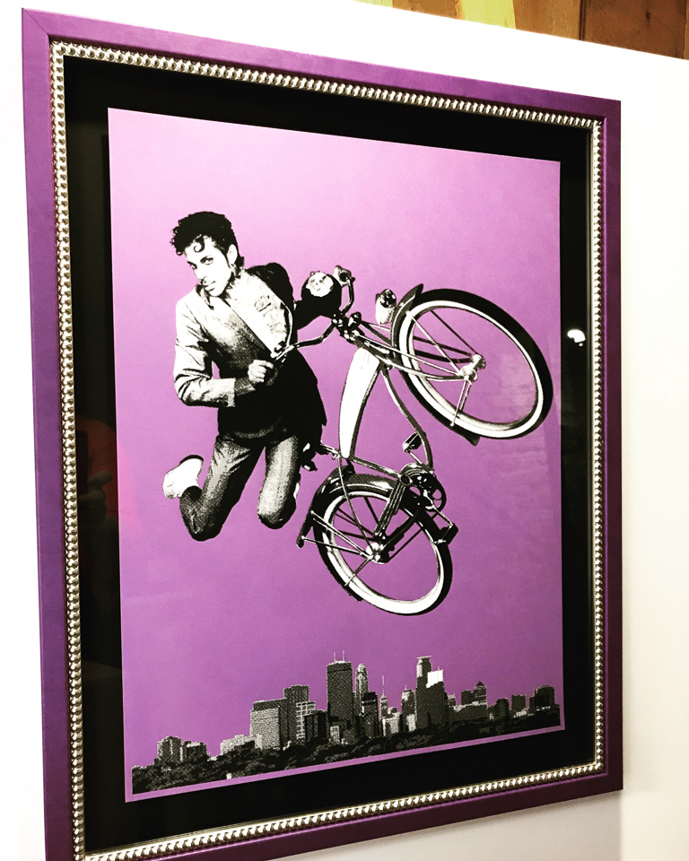 Poster by Artcrank artist - Prince as PeeWee. Framed in Prince's purple with silver beading.