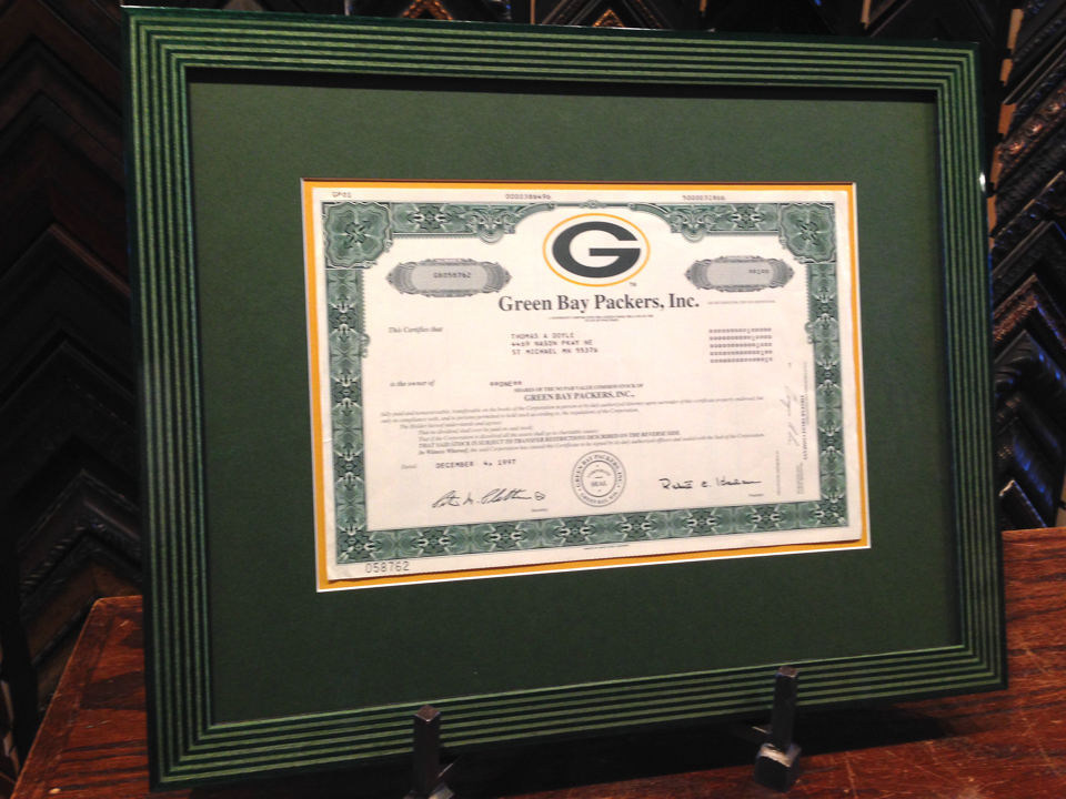 Packer Backer certificate framed in Packer Green striped marquetry frame.