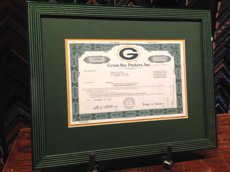 Packer Backer certificate framed in striped martquetry frame.