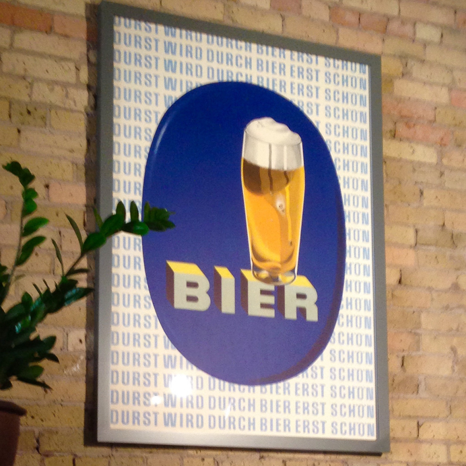 Vintage Bier poster framed in gray on maple.