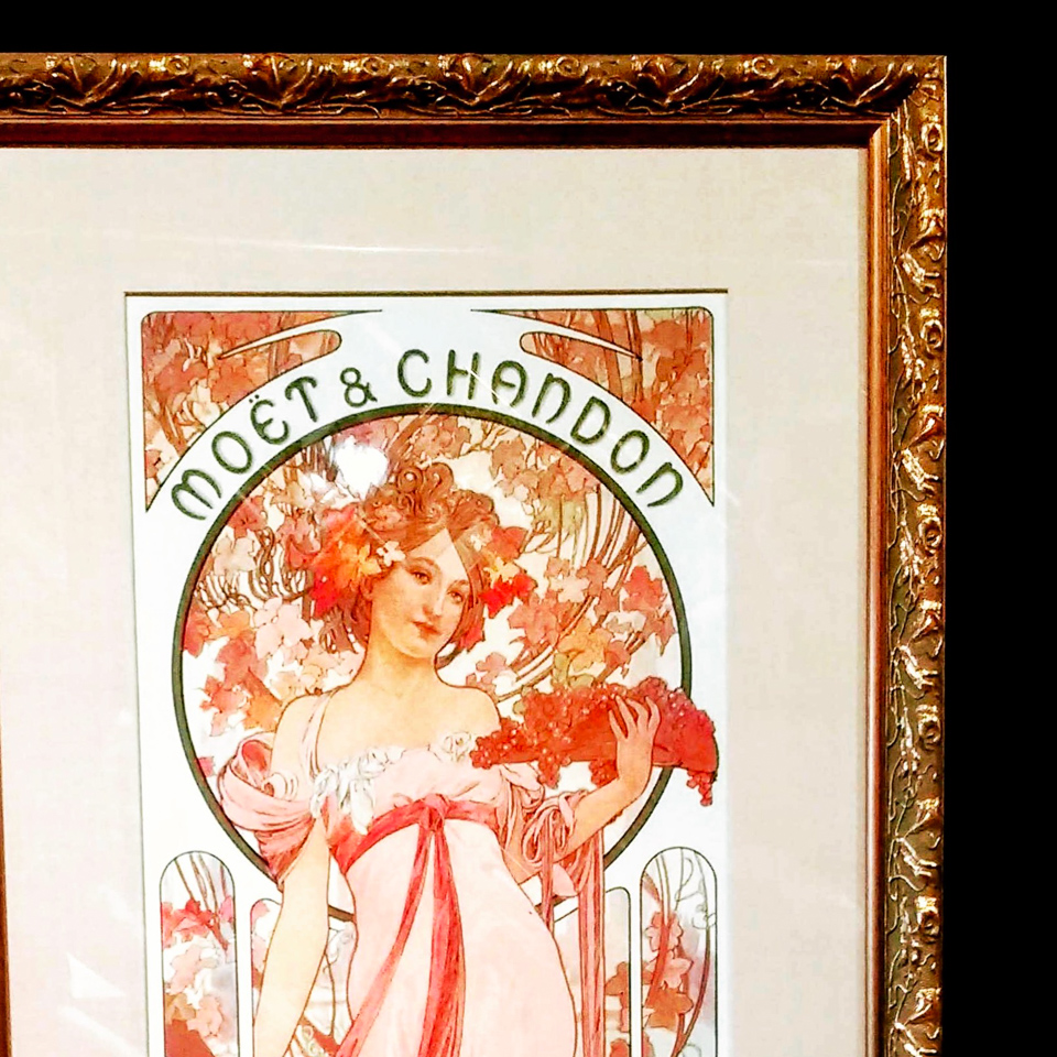 Mucha print framed in Art Nouveau patterned old gold frame.