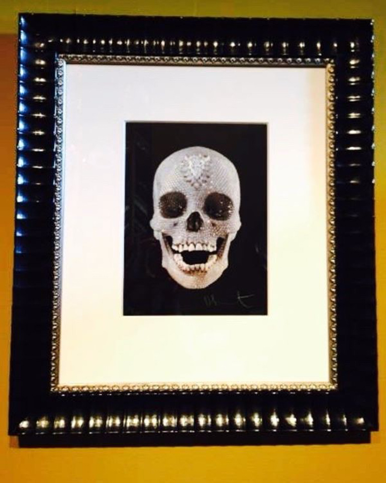 Bejeweled Damien Hirst print framed in patterned black with beaded silver fillet.