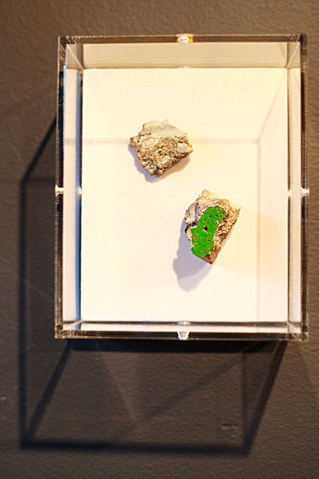 Pieces of the Berlin Wall framed in an acrylic box.