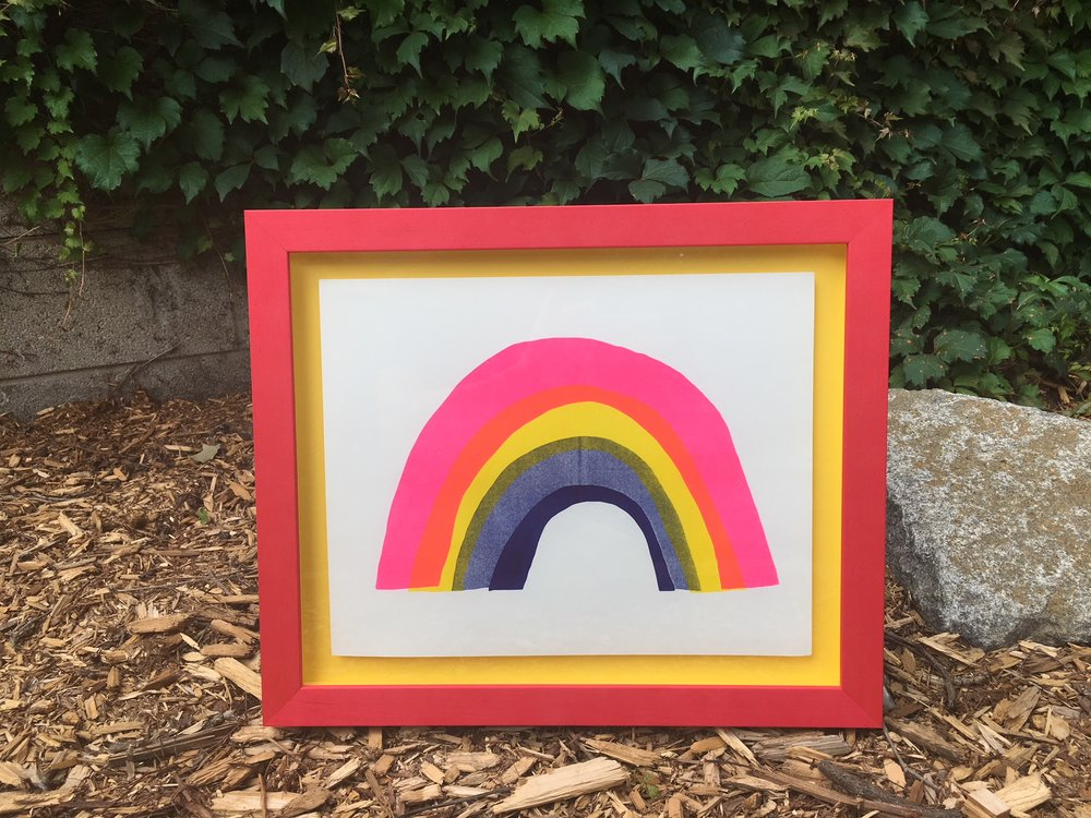 Rainbow print by Yellow Owl Workshop lifted and floated on yellow in watermelon pink frame.
