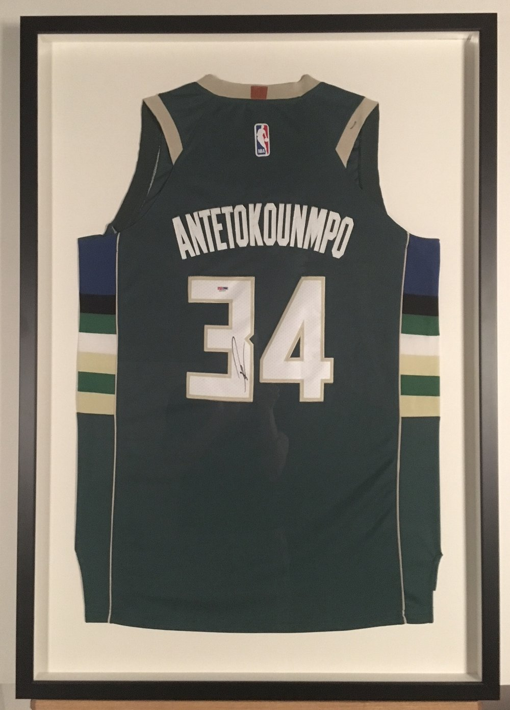 Autographed Milwaukee Buck's Antetokounmpo Jersey stitch mounted and shadowboxed in charcoal on maple.