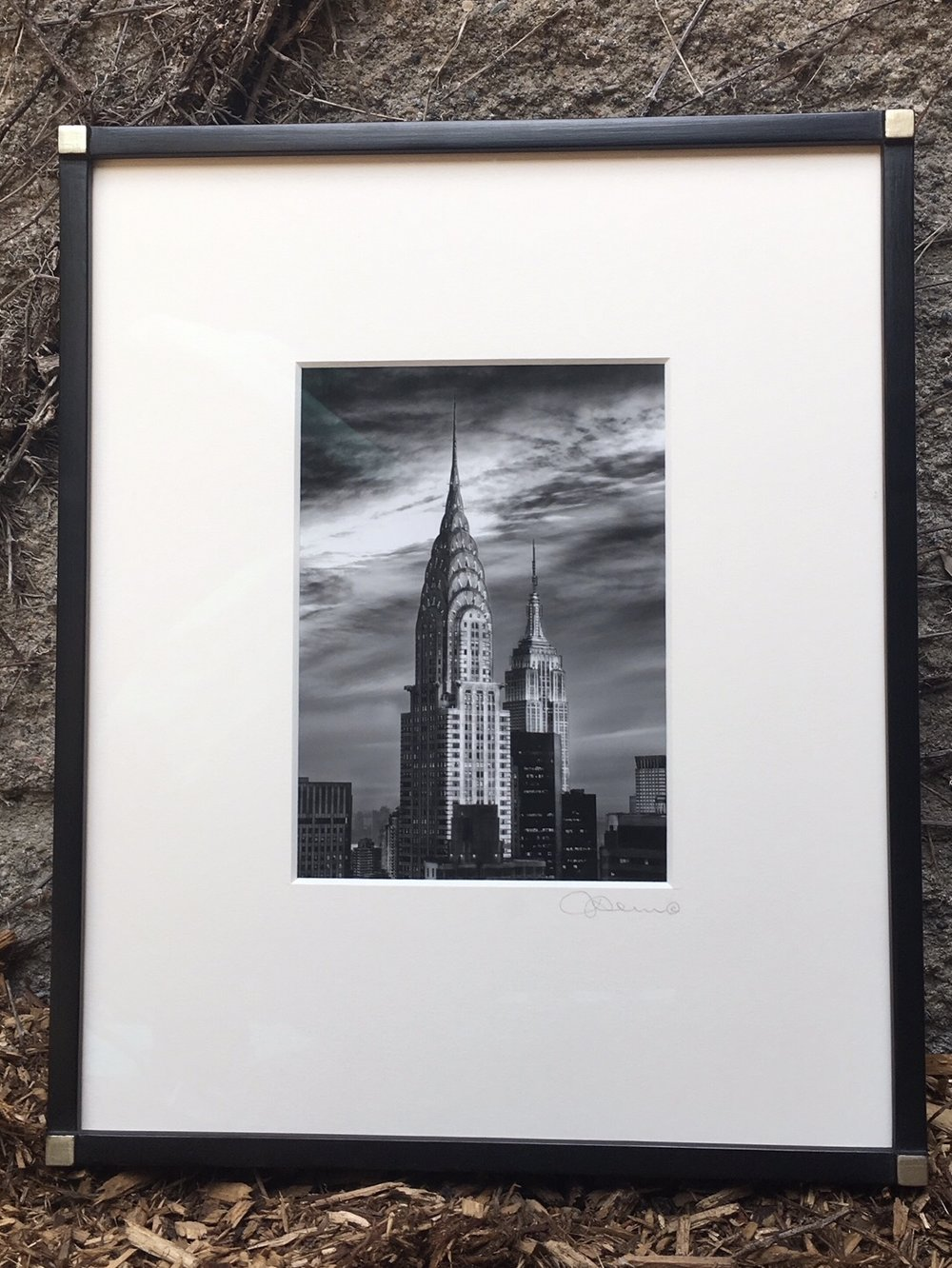 NYC photograph framed in black with white gold Hick's corners.