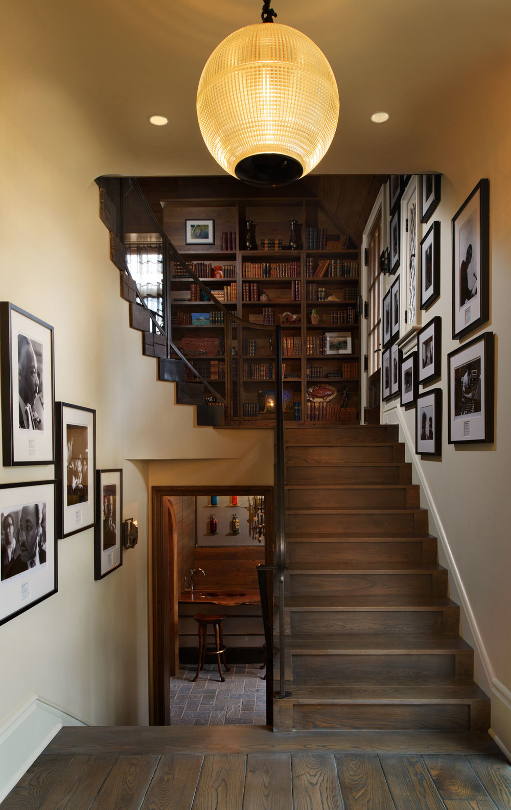 Flanked by a rare collection of photographs of Martin Luther King (left) and Elvis (right), these stairs lead up to a beautiful hardwood office space, or down to a relaxing bar and wine cellar.