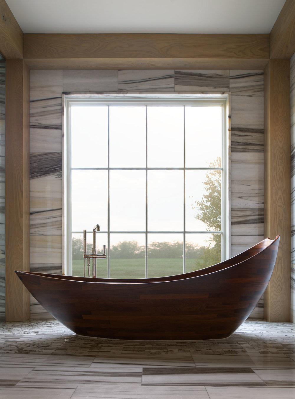 This hardwood tub serves and the visual centerpiece of the master retreat. While I didn't confirm with the homeowner, I'm pretty certain the tub is Brazilian Walnut (Ipe).