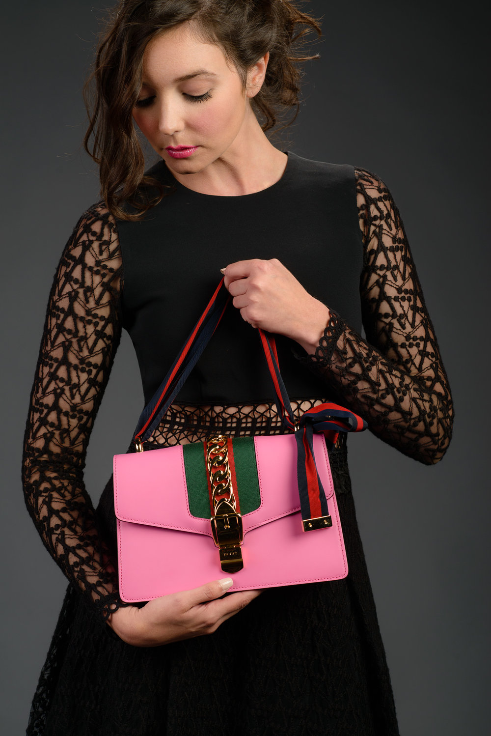 fashion-portrait-black-dress-pink-gucci-purse-bag.jpg