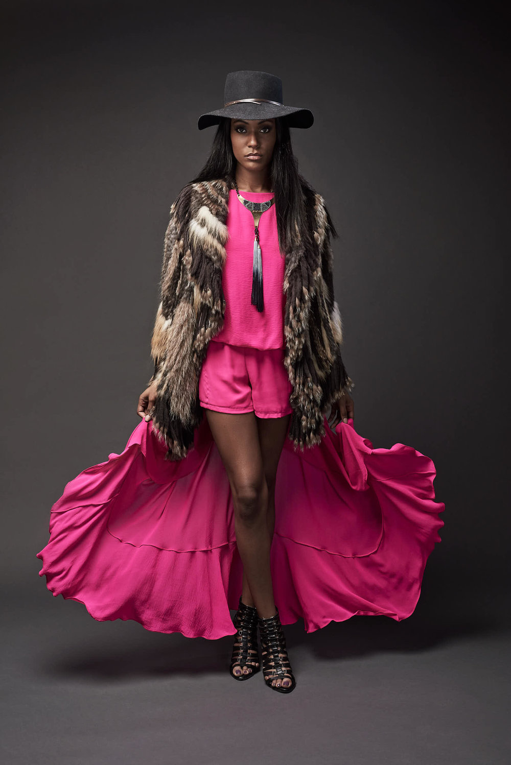 fashion-portrait-hat-pink-skort-flowing-fur-shawl.jpg