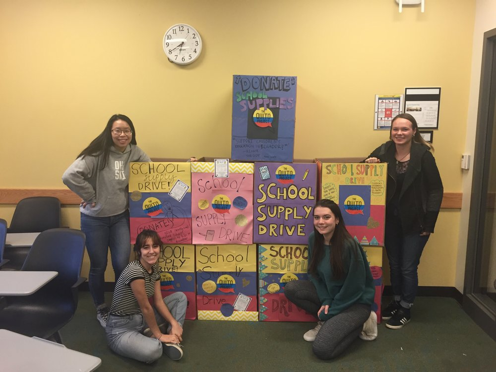 Members Nora Kuo, Francesca Romano, Megan Zabik, and Marina Ross with the completed donation boxes
