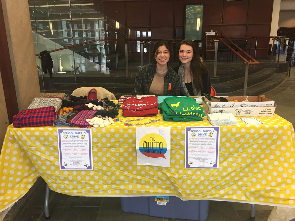 Members, Helen O'Leary and Marina Ross sell scarves and other items for a TQP fundraiser in Mason Hall.