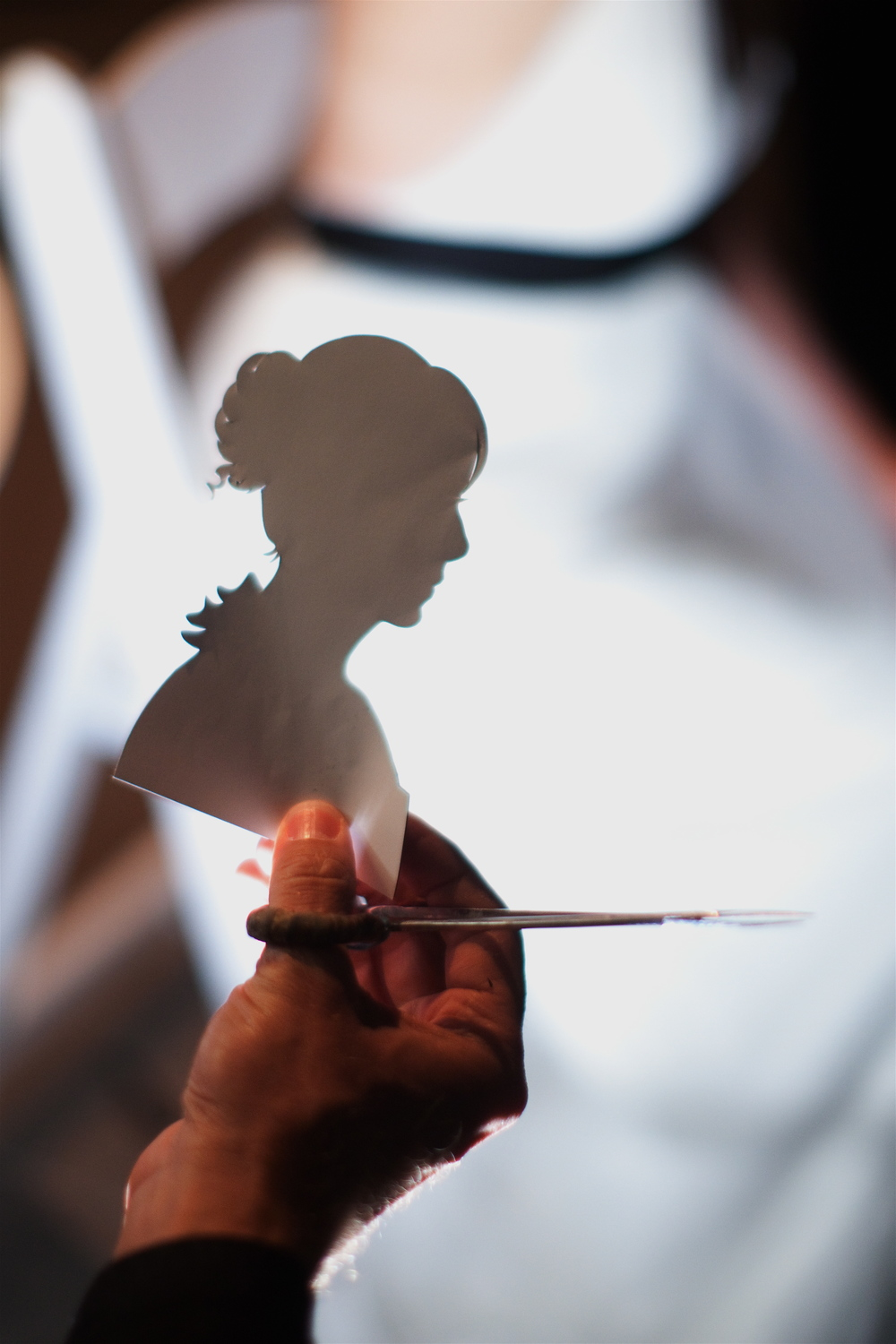 cutting portrait of Samantha Hanks with her in background.jpg