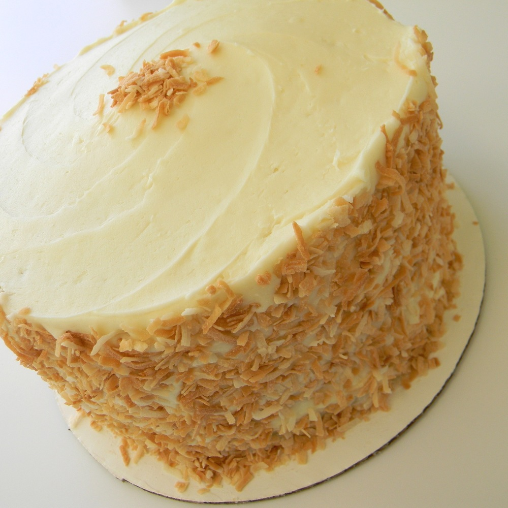Coconut Cake 4 layers of coconut cake filled with coconut cream and finished with cream cheese frosting and toasted coconut.