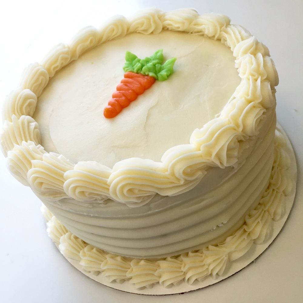 Carrot Cake   Three layers filled and finished with a soft cream cheese frosting.