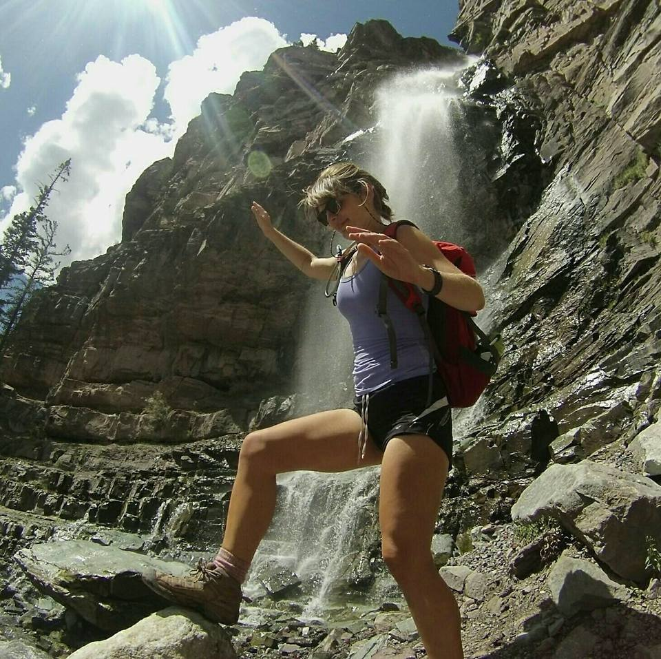 Brittany climbing on (falling off) rocks in the Uncompaghre National Forest in Ouray, Colorado