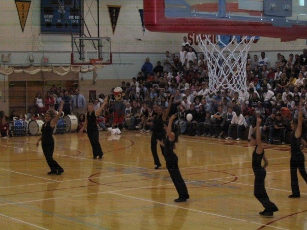 Holly Logan (pictured furthest away from the camera) on her high school dance team.