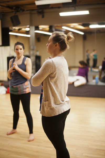 Artistic Director Holly Logan addressing the dance company members during rehearsal. Also pictured (from left to right): Dancers CarliAnn Forthun, Ciara McCormack, Jessica Mego & Lindsay Johns. Photo courtesy of  S. Weissbach Photography .